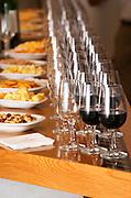 Wine tasting glasses in long rows and nibble finger food. Wine tasting. Wine glasses. Raimat Costers del Segre Catalonia Spain