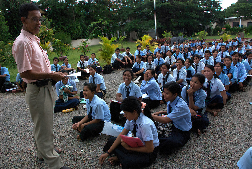 The headmaster of the Provincial Teacher Training College in Siem Reap, Cambodia addresses his students during an afternoon assembly.  The school prepares young adults to teach locally, and is free for all who students who pass the admission test.