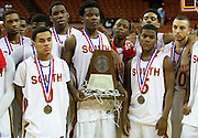 South Grand Prairie pose with their runner-up trophy after losing to Fort Bend Travis in the UIL 5A state championship game at the Frank Erwin Center in Austin on Saturday, March 9, 2013. (Cooper Neill/The Dallas Morning News)