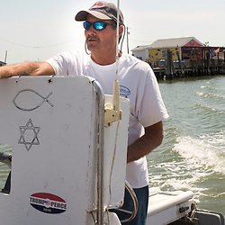 "August 4, 2017 - Tangier Island, VA - Tangier Island Mayor James ""Ooker"" Eskridge gives a tour of the area around Tangier Island from his skiff.  <br /> Photo by Susana Raab/Institute"