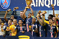 Thiago Silva of PSG holding the League Cup, Pablo Sarabia, goalkeeper Keylor Navas, Angel Di Maria, Presnel Kimpembe, Leandro Paredes and teammates celebrate the victory during the trophy ceremony following the French League Cup (Coupe de la Ligue) final match between Paris Saint-Germain (PSG) and Olympique Lyonnais (OL, Lyon) on July 31, 2020 at the Stade de France, in Saint-Denis, near Paris, France - Photo Juan Soliz / ProSportsImages / DPPI