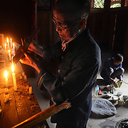 Feng Shui Master Wu lights incense and sacrifices a pig to thank heaven for his granddaughter's university entrance.