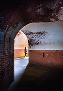 Textural red brick and shadowy arches of Fort Point, San Francisco