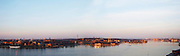 A wide panoramic evening view over Strommen Stockholm Strom with from left to right the af Chapman tree mast ship and youth hostel at Skeppsholmen, Kastellholmen Djurgarden and the straight leading out to the archipelago and Nacka. Stockholm, Sweden, Sverige, Europe
