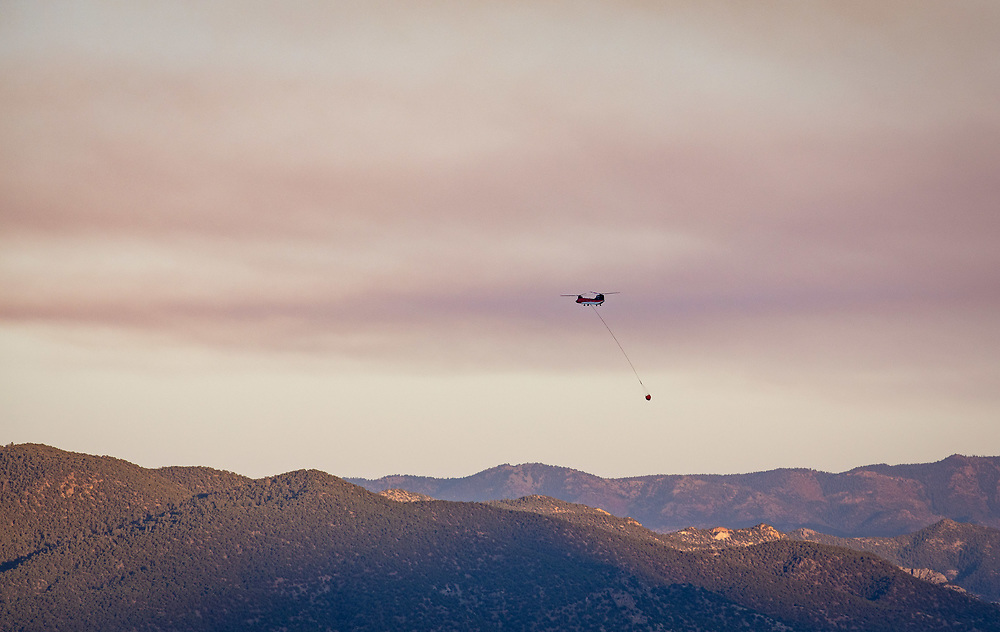 A Chinook helicopter heads toward Antero Reservoir to refill a large bucket to quench the Decker Fire threatening areas near Salida.