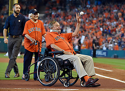 With former First Lady Barbara Bush behind him, former President George H.W. Bush throws the ceremonial first pitch before an ALDS baseball game between the Houston Astros and the Kansas City Royals on Sunday, Oct. 11, 2015, at Minute Maid Park in Houston. Photo by John Sleezer/Kansas City Star/TNS/ABACAPRESS.COM  | 519441_001 HOUSTON