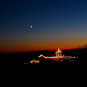 Small church in Central Portugal lighted for Summer festivities