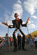Mandatory Credit: Photo by STEVE MEDDLE / Rex Features<br /> GIANT PUPPET<br /> GLASTONBURY FESTIVAL DAY 2, BRITAIN - 28 JUN 2003<br /> <br /> PUPPETEER