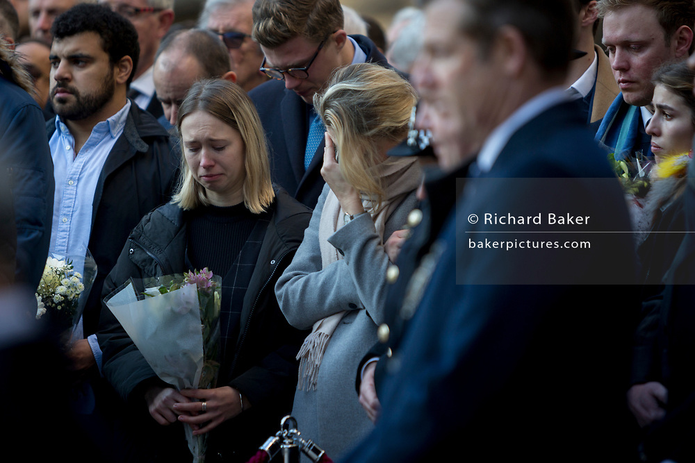 Three days after the killing of Jack Merritt, 25, and Saskia Jones, 23, by the convicted teorrorist Usman Khan at Fishmongers' Hall on London Bridge, emotional friends and families of the victims and Prime Minister Boris Johnson, Leader of the Opposition Jeremy Corbyn, London Mayor Sadiq Khan plus City and police officials, hold a vigil at the Guildhall in the City of London, on 2nd December 2019, in London, England.