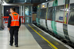 © Licensed to London News Pictures. 06/12/2016. London, UK. Southern Rail workers walk at Victoria Station in London on 6 December 2016, as hundreds of thousands of rail passengers face a days of travel chaos because of a 72-hour strike in an escalating dispute over the role of conductors between Southern Rail and the RMT Union. Photo credit: Tolga Akmen/LNP