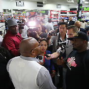 LAS VEGAS, NV - APRIL 14: CEO of Mayweather Promotions Leonard Ellerbe speaks to the media at a workout by WBC/WBA welterweight champion Floyd Mayweather Jr. at the Mayweather Boxing Club on April 14, 2015 in Las Vegas, Nevada. Mayweather will face WBO welterweight champion Manny Pacquiao in a unification bout on May 2, 2015 in Las Vegas.  (Photo by Alex Menendez/Getty Images) *** Local Caption *** Leonard Ellerbe
