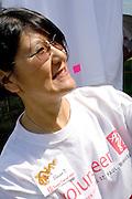 Volunteer woman age 50. Dragon Festival Lake Phalen Park St Paul Minnesota USA