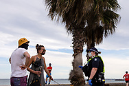 Police speak to locals during COVID-19 in Melbourne, Australia. Premier Daniel Andrews comes down hard on Victorians breaching COVID 19 restrictions, threatening to close beaches if locals continue to flout the rules. This comes as Victoria sees single digit new cases. (Photo by Dave Hewison/Speed Media)