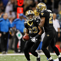 January 7, 2012; New Orleans, LA, USA; New Orleans Saints cornerback Jabari Greer (33) celebrates with safety Malcolm Jenkins (27) following a interception against Detroit Lions wide receiver Titus Young (16) during the 2011 NFC wild card playoff game at the Mercedes-Benz Superdome. Mandatory Credit: Derick E. Hingle-US PRESSWIRE