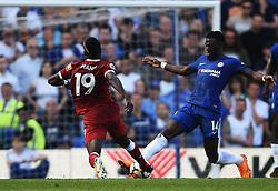 Chelsea's Tiemoue Bakayoko tackles Liverpool's Sadio Mane