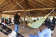A Surui meeting of tribes in their traditional meeting hut, where they write up a declaration to defend their land against deforestation. <br /><br />An Amazonian tribal chief Almir Narayamogo, leader of 1350 Surui Indians in Rondônia, near Cacaol, Brazil, with a $100,000 bounty on his head, is fighting for the survival of his people and their forest, and using the world's modern hi-tech tools; computers, smartphones, Google Earth and digital forestry surveillance. So far their fight has been very effective, leading to a most promising and novel result. In 2013, Almir Narayamogo, led his people to be the first and unique indigenous tribe in the world to manage their own REDD+ carbon project and sell carbon credits to the industrial world. By marketing the CO2 capacity of 250 000 hectares of their virgin forest, the forty year old Surui, has ensured the preservation, as well as a future of his community. <br /><br />In 2009, the four clans and 25 Surui villages voted in favour of a total moratorium on logging and the carbon credits project. <br /><br />They still face deforestation problems, such as illegal logging, and gold mining which causes pollution of their river systems
