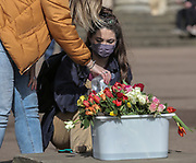 Cheltenham Flower Lay for Sarah Everard, 13th March, 2021.  Members of the public sanitise their hands before handling flowers in memory of Sarah Everard.