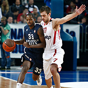 Anadolu Efes's Oliver Lafayette (L) and Olympiacos's Konstantinos Papanikolaou (R) during their Turkish Airlines Euroleague Basketball Top 16 Group E Game 4 match Anadolu Efes between Olympiacos at Sinan Erdem Arena in Istanbul, Turkey, Wednesday, February 08, 2012. Photo by TURKPIX
