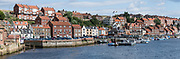 Whitby and the Esk River, in North Yorkshire county, England, United Kingdom, Europe. This was at the end of our England Coast to Coast hike, on day 13 of 14. The next day, our 14th, ended being dropped off in York. [This image, commissioned by Wilderness Travel, is not available to any other agency providing group travel in the UK, but may otherwise be licensable from Tom Dempsey – please inquire at PhotoSeek.com.] This image was stitched from multiple overlapping photos.