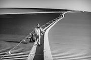 Abu Dhabi, 8 feb 2010, Worker on the roof of Ferrari world at Yas island