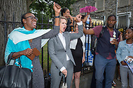 New York Gubernatorial candidate Cynthia Nixon,(center) raises her fist  with Ohio state senator Nina Turner, at a campaign rally in Flatbush, Brooklyn. At right, is Jumaane Williams, the Democratic candidate for Lieutenant Governor of New York.