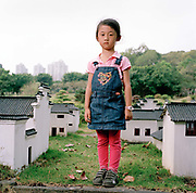 Du Jing Peng, 5 photographed at Splendid China miniature village theme park in Shenzhen, ..Sun Linang, 30 is a single, full-time mother to her daughter Du Jing Peng, 5. Linang is divorced but would like to find a new partner, ideally with no children of his own so that if they decided to have one together, they would not have to pay...Its over thirty years (1978) since the Mao's Chinese government brought in the One Child Policy in a bid to control the world's biggest, growing population. It has been successful, in controlling growth, but has led to other problems. E.G. a gender in-balance with a projected 30 million to many boys babies; Labour shortages and a lack of care for the elderly.