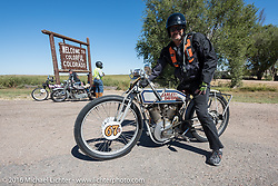 Harley-Davidson Museum Archive Restorer/Conservator Bill Rodencal of Wisconsin on his 1915 Harley-Davidson stops to capture the moment as he crosses over from Kansas into Colorado during the Motorcycle Cannonball Race of the Century. Stage-9 Dodge City, KS to Pueblo, CO. USA. Monday September 19, 2016. Photography ©2016 Michael Lichter.