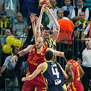 Fenerbahce's Darjus LAVRINOVIC (B) and Galatasaray CC's Ermal KURTOGLU (C) during their Turkish Basketball Legague Play-Off final fifth match Fenerbahce between Galatasaray at the Sinan Erdem Arena in Istanbul Turkey on Tuesday 14 June 2011. Photo by TURKPIX