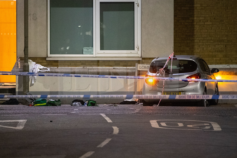 © Licensed to London News Pictures. 13/05/2020. London, UK. A car that has collided with a wall on Lombard Street sits on the pavement alongside medical packs. Police were called at around 1800BST on Wednesday, 13 May, to reports of a man with a knife in Lombard Road, SW11. There were also reports of a car in collision with a wall in Lombard Road. Officers attended the location and found two men injured - one had cuts to his arms and the other cuts to his legs. Officers believed the two men had been travelling in the car. Both have been taken to hospital, where their injuries are not believed to be life-threatening. Investigations at the scene led officers to Vicarage Crescent, SW11, where they found two other injured men. Both were taken to hospital with non life-threatening injuries. Photo credit: Peter Manning/LNP