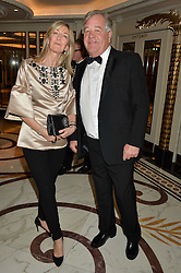 LAURA WEINSTOCK and SIR MICHAEL STOUTE at the 24th Cartier Racing Awards held at The Dorchester, Park Lane, London on 11th November 2014.