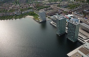 Nederland, Flevoland, Almere, 28-04-2010. Almere centrum, Weerwater met de woontorens Side by Side aan de oever..Almere center, with residential towers Side by Side on the shore..luchtfoto (toeslag), aerial photo (additional fee required).foto/photo Siebe Swart