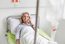 Patient in hospital phoning from bed