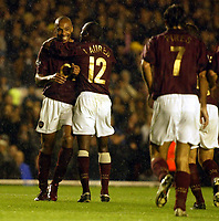 Photo: Chris Ratcliffe.<br />Arsenal v Sparta Prague. UEFA Champions League.<br />02/11/2005.<br />Thierry Henry (L) celebrates and takes the mickey out of Robert Pires at the same time