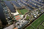 Nederland, Utrecht, Maarssenveensche Plassen, 08-03-2002; dagrecreatie in de Molenpolder: stacaravans met eigen steiger (!) en tuinhuisjes in plassengebied, gemeenschappelijke tennisbaan; camping kamperen watersport toerisme tweede huisje vakantie caravan;<br /> luchtfoto (toeslag), aerial photo (additional fee)<br /> foto /photo Siebe Swart