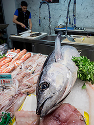 Seafood for sale at fish market, man working in background, Getxo, Algorta, Basque Country, Biscay, Spain, Europe