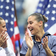 Flavia Pennetta, (right), with Roberta Vinci, Italy, at the trophy presentation after the Women's Singles Final match during the US Open Tennis Tournament, Flushing, New York, USA. 12th September 2015. Photo Tim Clayton