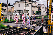 every day Street scene in Japan. Japanese women in traditional Kimono