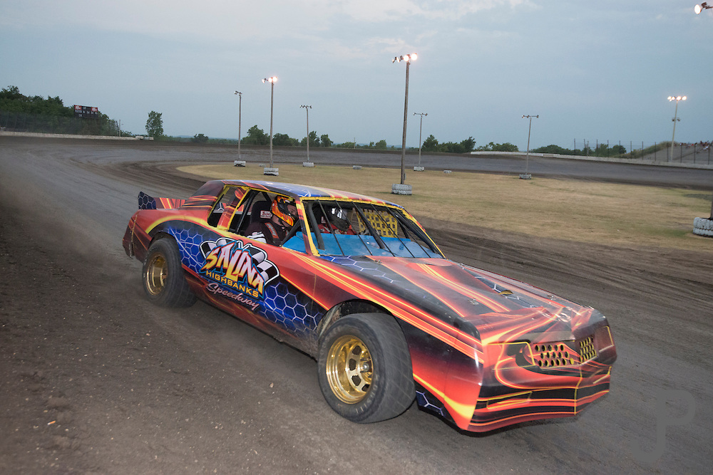 Track owner Bob Hanna takes a lucky spectator on fast laps in his two seat race car during intermisison.  Spectators purchase a ticket to enter a drawing each Saturday night, and the winner gets to ride with Bob in his two seat race car.