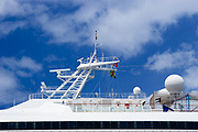 Radar and satellite communications mast on Carnival Destiny cruise ship docked in Roseau, Dominica <br />
