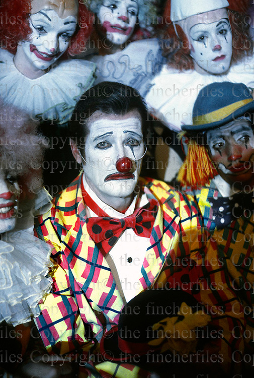British actor Roger Moore dresses as a clown in his role as James Bond in the 1983 movie Octopussy. Captured at Pinewood Studios in England by multi award winning photographer Terry Fincher.