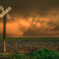 Mammatus clouds at sunset over a railroad crossing in eastern New Mexico.