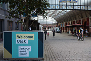 A sign indicates a return to non-essential shopping in accordance with physical distancing guidelines in Windsor Royal Station on 13th June 2020 in Windsor, United Kingdom. The British government is permitting most retailers to open their premises with effect from 15th June provided that they follow COVID-19 safety guidelines.