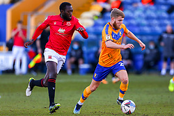 Toumani Diagouraga of Morecambe chases down Jason Law of Mansfield Town - Mandatory by-line: Ryan Crockett/JMP - 27/02/2021 - FOOTBALL - One Call Stadium - Mansfield, England - Mansfield Town v Morecambe - Sky Bet League Two