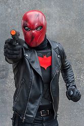 © Licensed to London News Pictures. 24/05/2015. London, UK. A man dressed as Red Hood poses, as fans of anime, comic books, video games and more gather in large numbers at the Excel Centre to attend the bi-annual MCM Comic Con. Photo credit : Stephen Chung/LNP