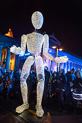 "Edinburgh, Scotland, UK. 31st Dec 2019. Edinburgh's famous Hogmanay party. Pictured Edinburgh's Harbingers Drum Crew with Germany's ""Gentle Giants of Light"", Dundu. Iain Masterton/Alamy Live News"
