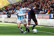 Cyrus Christie of Derby County shields the ball from Harry Bunn of Huddersfield town. Skybet football league Championship match, Huddersfield Town v Derby county at the John Smith's Stadium in Huddersfield , Yorkshire on Saturday 24th October 2015.<br /> pic by Chris Stading, Andrew Orchard sports photography.