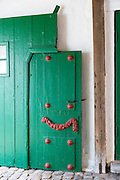 Painted green door in medieval Ribe centre, South Jutland, Denmark
