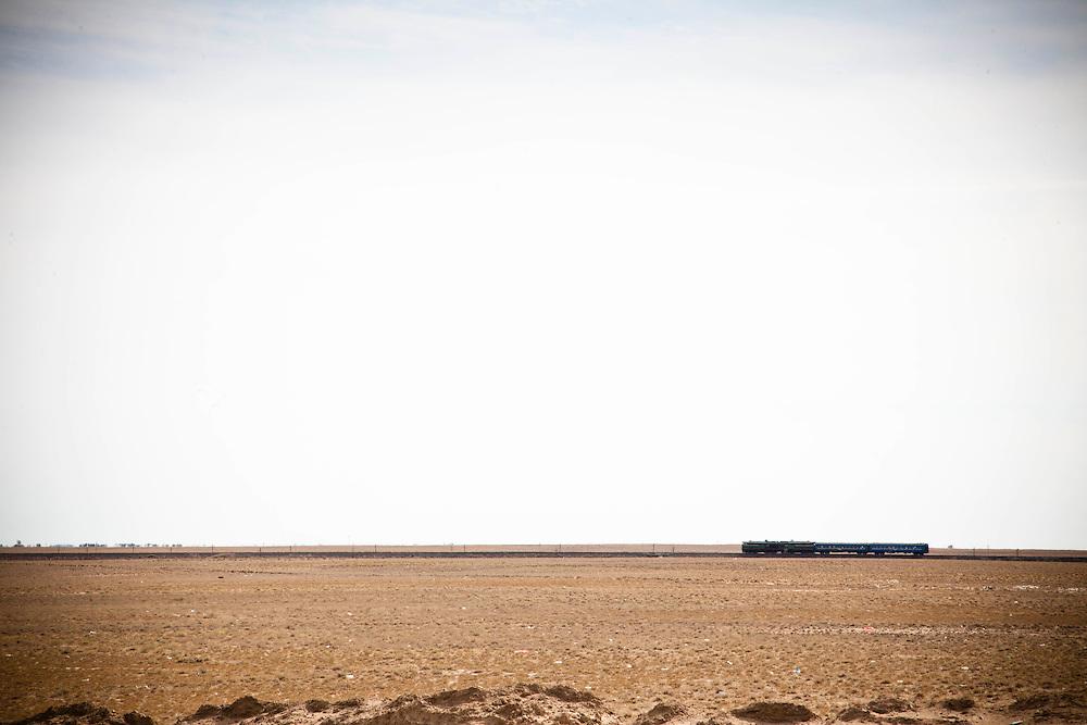 A train is seen in the middle of desert, Kazakhstan.