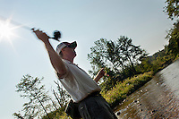 angler Jay Ericson casting while wet wading the Dog River, Vermont
