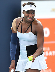 March 24, 2019 - Miami, FL, USA - Venus Williams smiles when she hears a baby crying in the stands as she prepares to serve to Daria Kasatkina on Sunday, March, 24, 2019 at the Miami Open in Miami Gardens, Fla. (Credit Image: © Charles Trainor Jr/Miami Herald/TNS via ZUMA Wire)